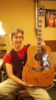 "This Gibson was signed by Johnny Cash, Warren Zevon, Clarence ""Gatemouth"" Brown, and some random guy. What you can"
